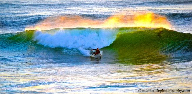 A surfer enjoying some waves at Windansea Beach, CA