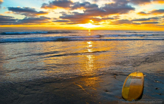 A Surfboard along the shore in Solana Beach.